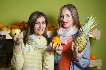 Natural pretty girls smiling while holding fruit, healthy life