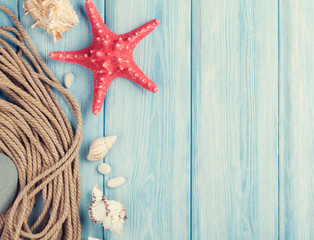 Sea vacation background with star fish and marine rope
