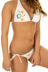 woman in white bikini body arms hanging down