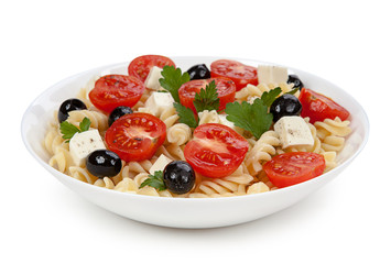 Pasta salad in the plate isolated on white background