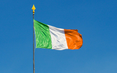 Ireland flag with pole waving blue sky text space vivid colors