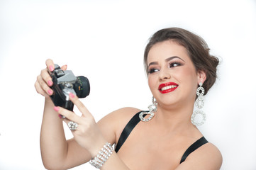 Beautiful young girl with make-up taking photos of herself
