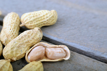 The Peanut On Wooden Background