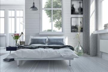 Double divan bed in a light spacious bedroom