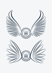 Set of two outlined heraldic designs with wings and crown