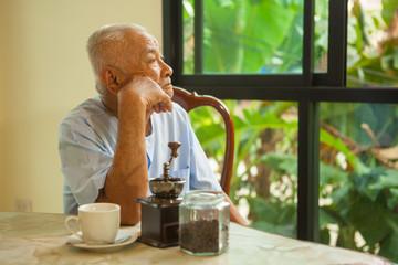 Asian senior man thinking about something