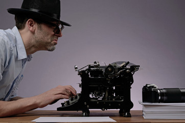Agent with an old type writer and a vintage camera