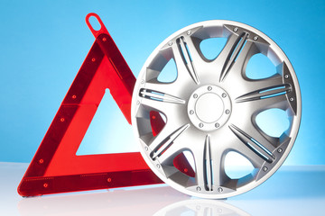 alloy wheel and warning trangle