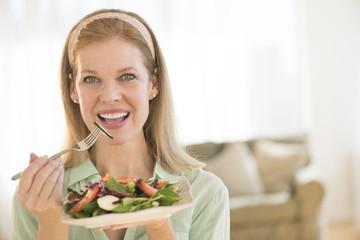 Smiling Mature Woman Having Healthy Salad At Home