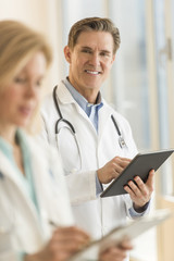 Male Doctor Using Digital Tablet At Hospital