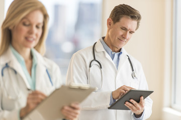 Male Doctor Using Digital Tablet At Hospital