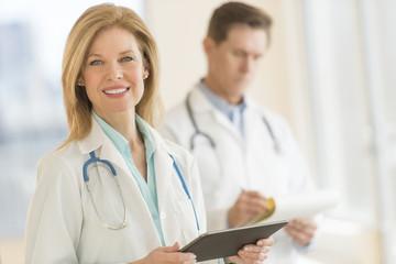 Female Doctor Using Digital Tablet At Hospital