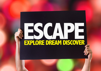 Escape Explore Dream Discover card with bokeh background