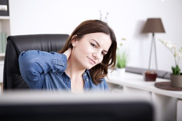 Tired Office Woman Holding Back of her Neck