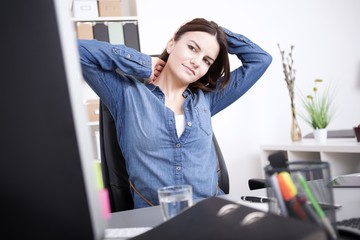 Exhausted Office Woman Holding her Head and Neck