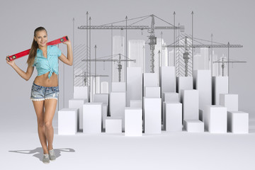 Worker holding builders level on shoulders. White cubes with