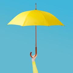 Hand holding an umbrella