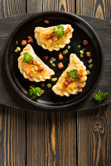 Fried dumplings with onion and bacon top view