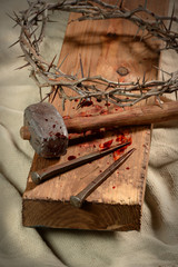 Cross With Nails, Crown of Thorns and Hammer