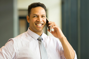 middle aged employee talking on mobile phone