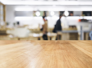Table top with People and blurred kitchen background