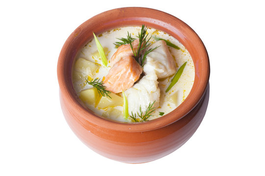 fish soup cream in pot on a white background