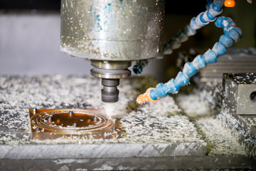 CNC drilling machine in a modern plant making plastic detail