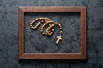 rosary beads in wooden frame