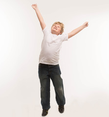 kid child studio boy portrait on white is jumping