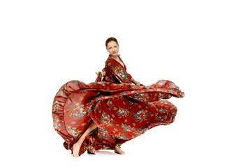 Young beautiful woman dancing gypsy dance