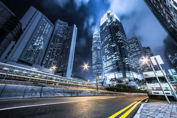 Busy traffic light trails and office buildings.