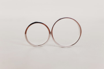 Golden wedding rings on white background. Jewelry