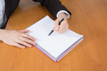 signing a contract with shallow focus on signature.