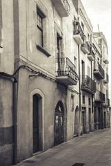 Narrow empty street view of Tarragona. Vintage stylized
