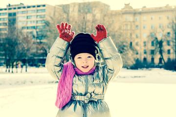 Portrait of little girl outdoors in winter