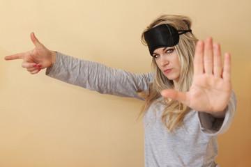 Angry young women with the sleeping eye mask
