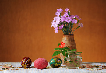 Easter colored eggs and flowers