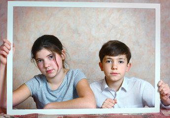 siblings brother and sister cute portrait in frame