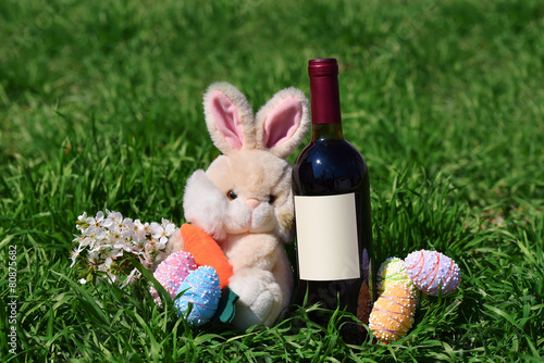 Wall mural Row of Easter eggs red wine bottle rabbit in Grass