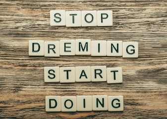 Art. Stop dreaming. Start doing. Motivational text on a wooden