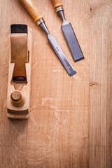 chisels and woodworkers plane on wooden board construction conce