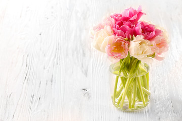 Bouquet of fresh tulips on wooden background