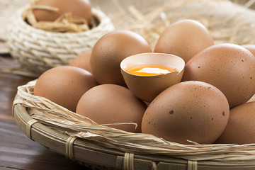 Organic eggs on wooden table.