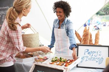 Female Bakery Stall Holder At Farmers Fresh Food Market