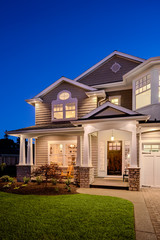 Beautiful New England Style Home Exterior at Night
