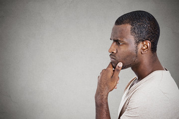 Portrait thoughtful young man isolated ion gray background