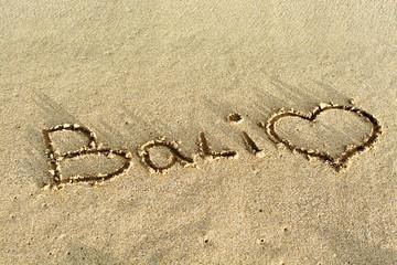 Bali beach writing in sand