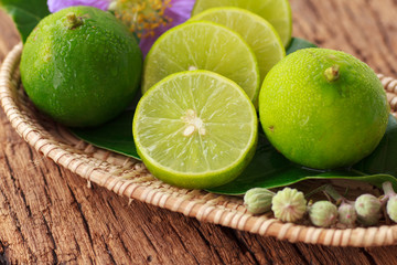Lime on wooden background - Stock Image