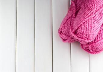 Pink balls of woolen threads in the corner
