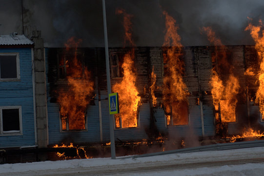 Fire fighters try to save a home